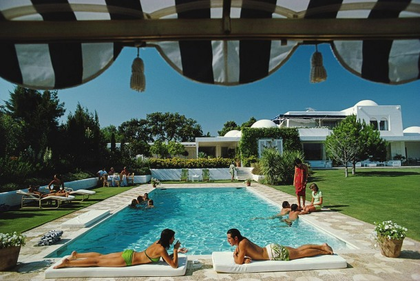 Bathers round a pool in Sotogrande, Spain, August 1975.