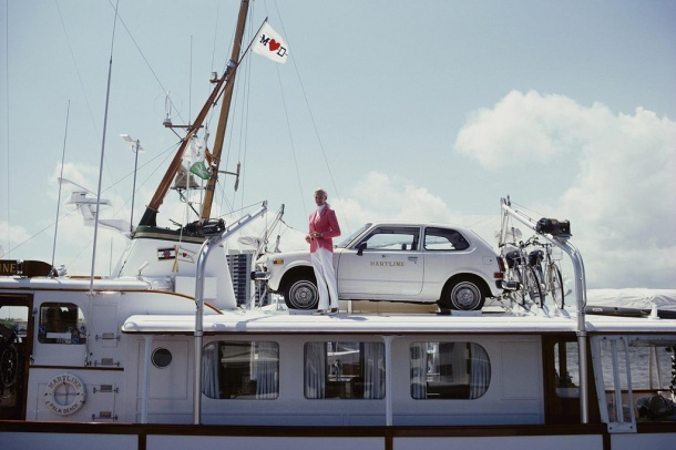 Mrs. Woolworth Donahue with car and bicycles on her motor yacht, 'Hartline'.